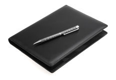 Black leather datebook and pen Stock Photo