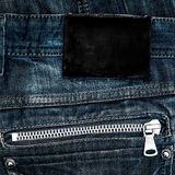 Black leather empty label on back jeans Royalty Free Stock Photos