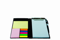A black leather executive folder on timber desk with sticky note Royalty Free Stock Photos