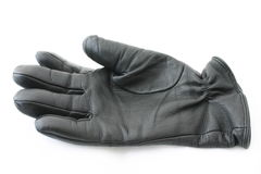 Black leather glove. Glove casts a small shadow in front of it Stock Photography