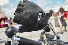 Black leather glove on handlebars royalty free stock photography