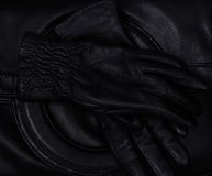 Black leather. Gloves lying on a  bag Stock Photography