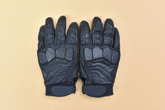 Black leather gloves for riding a motorcycle or bicycle Royalty Free Stock Photos