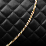 Black leather with golden chain Royalty Free Stock Photography