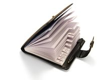 Black leather half-open notepad. With pen. Isolated royalty free stock image