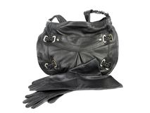 Black leather handbag and pair of gloves Royalty Free Stock Photo