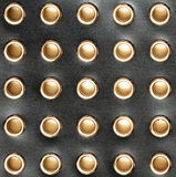 Black leather with holes. For background Stock Photos