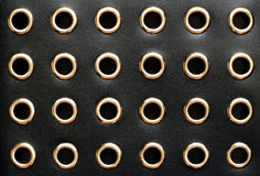 Black leather with holes. For background Royalty Free Stock Image