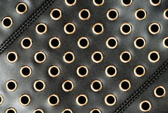 Black leather with holes Stock Photos