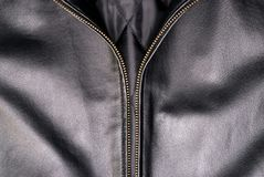 Black leather jacket. Close up of a black leather jacket and a gold zipper royalty free stock images