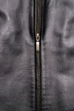 Black leather jacket. Close up of a black leather jacket and a gold zipper royalty free stock image