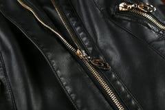 A black leather jacket background. Stock Image