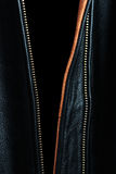 Black leather jacket detail Stock Images