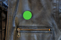 Black leather jacket with pin badge Royalty Free Stock Image