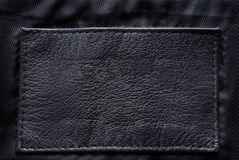 Black leather label. Closeup of the black leather label Stock Photography