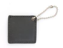 Black Leather Luggage Tag. On White background macro shot Stock Photography