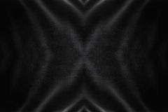 Black leather luxurious background texture with central cross. Luxury black leather background texture photograph for design Royalty Free Stock Images
