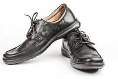 Black leather male shoes, white background stock photos