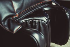 Black leather massage chair. Close-up at the Mall Royalty Free Stock Photo