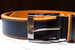Black leather men`s belt with silver buckle, close up. Clothes Royalty Free Stock Image