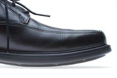 Black leather men's dress shoe (toe) Stock Photo