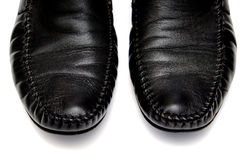 Black leather men shoes against white background. Black leather used shoes for men isolated on a white background.Horizontal close up shot Stock Photo