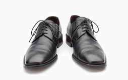 Black leather mens shoes. On white background Royalty Free Stock Photography