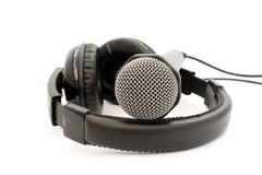 Black leather microphone and headphones Royalty Free Stock Photo