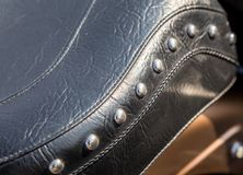 Black leather motorcycle saddle with rivets Stock Photo