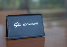 A black leather no smoking sign. Displayed on a  table Stock Photos