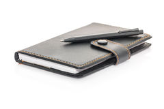 Black leather note book and pen on white Stock Image