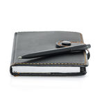 Black leather note book and pen on white Stock Photo
