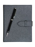 Black leather notebook and pen Royalty Free Stock Photography