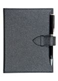 Black leather notebook and pen Stock Images