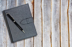 Black leather notebook with pen Royalty Free Stock Image