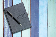 Black leather notebook with pen Royalty Free Stock Images