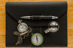 black leather organizer with key and pocket watch Stock Photography
