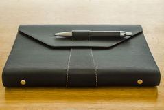Black leather organizer with pen Stock Photos
