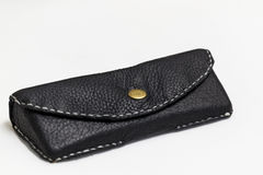 Black leather pouch for glasses. Black leather pouch for glasses - isolated on white background Royalty Free Stock Images