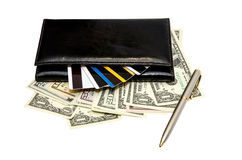 Black leather purse with banknotes and credit cards Royalty Free Stock Images