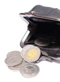 Black leather purse with coins. White background Royalty Free Stock Images