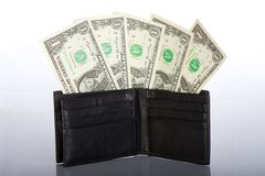Black leather purse with one dollar banknotes Stock Photography