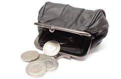 Black leather purse with silver coins. White background Royalty Free Stock Image