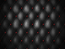 Black leather with red buttons Stock Images