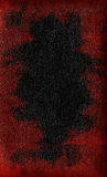 Black leather with red spots. Texture of a black leather with red spots Royalty Free Stock Images