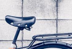 Black leather saddle and stacks bike Royalty Free Stock Image