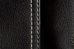 Black leather with with seams close-up Royalty Free Stock Photography