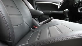 Black leather seat covers in the car. beautiful leather car interior design. stylish leather seats in the car. luxury. Black leather seat covers in car stock video footage