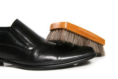 Black leather shoe and brush Royalty Free Stock Images