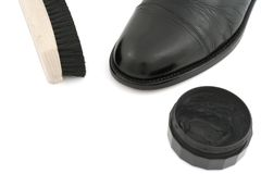 Black leather shoe with brush and polish Stock Image